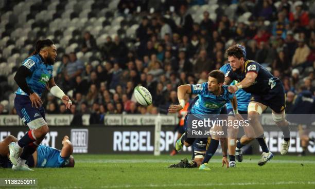 Otere Black of the Blues offloads to Ma'a Nonu during the round 10 Super Rugby match between the Highlanders and the Blues at Forsyth Barr Stadium on...