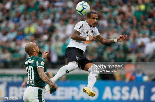 Otero of Atletico MG jumps for the ball against Felipe Melo of Palmeiras during a match between Palmeiras and Atletico MG for the Brasileirao Series...