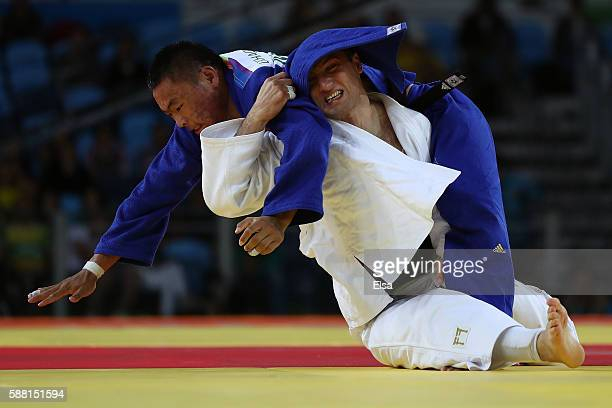 Otgonbaatar Lkhagvasuren of Mongolia competes against Varlam Liparteliani of Georgia during a Men's 90kg Quarterfinal bout on Day 5 of the Rio 2016...