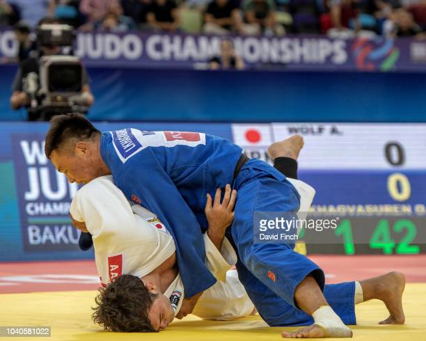 Otgonbaatar Lkhagvasuren of Mongolia throws Aaron Wolf of Japan for an iippon to win the u100kg bronze medal during day six of the 2018 Judo World...