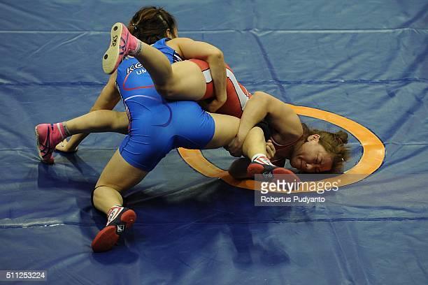 Otgontsetseg Davaasukh of Mongolia competes against Jieun Um of Korea in the Women's Freestyle Senior 55 kg quarterfinal match during the 2016...