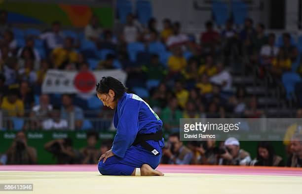 Otgontsetseg Galbadrakh of Kazakhstan reacts after being defeated by Ami Kondo of Japan in the Women's 48 kg Judo on Day 1 of the Rio 2016 Olympic...