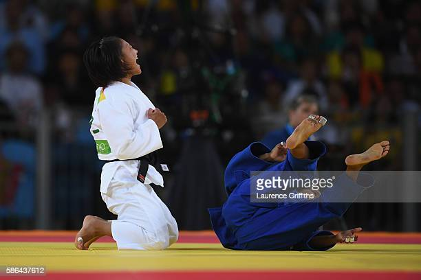 Otgontsetseg Galbadrakh of Kazakhstan reacts after defeating Dayaris Mestre Alvarez of Cuba during the women's 48kb Bronze Medal B judo contest on...