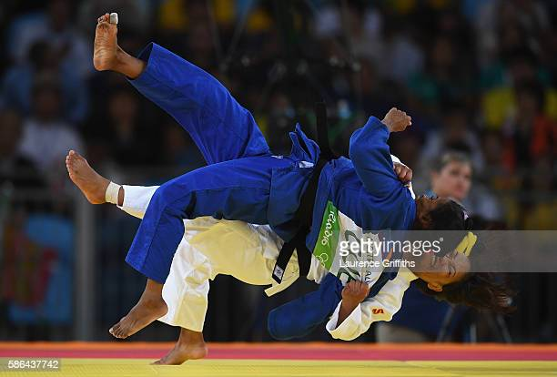 Otgontsetseg Galbadrakh of Kazakhstan takes down Dayaris Mestre Alvarez of Cuba during the women's 48kb Bronze Medal B judo contest on Day 1 of the...