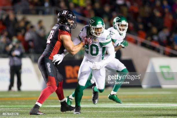 Otha Foster III of the Saskatchewan Roughriders rushes the Ottawa Redblacks pass The Saskatchewan Rough Riders defeated the Ottawa Redblacks 1817 in...