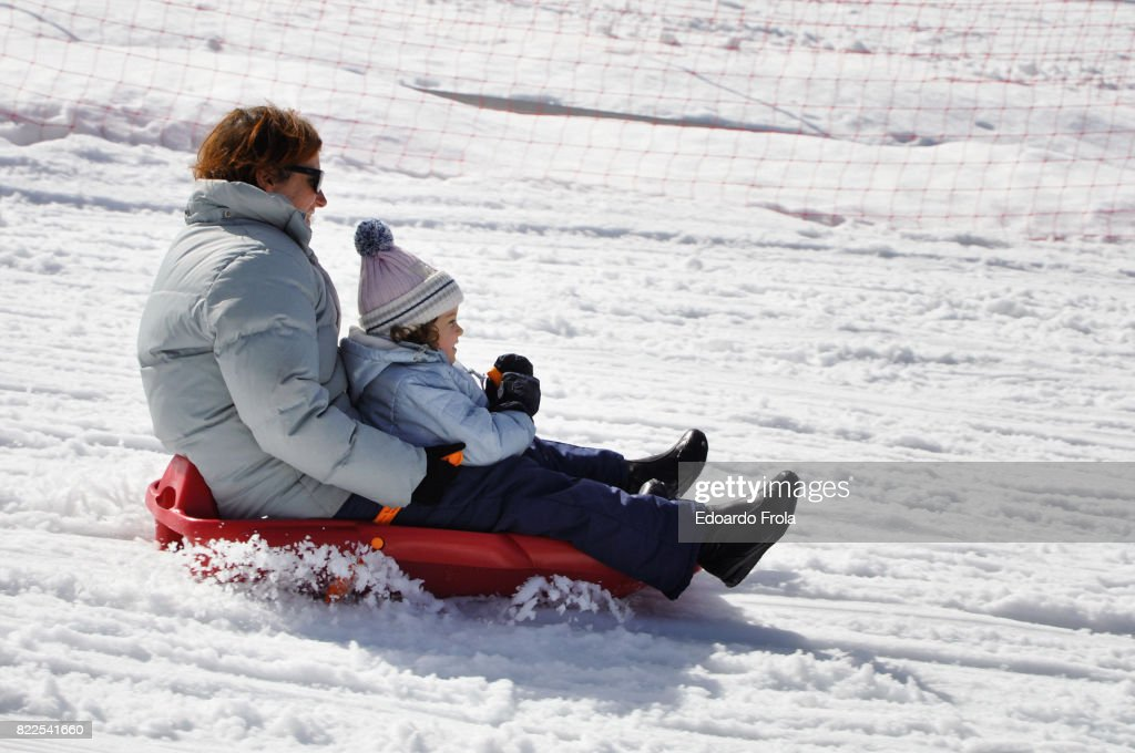 other and daughter on a red bob : Stock Photo