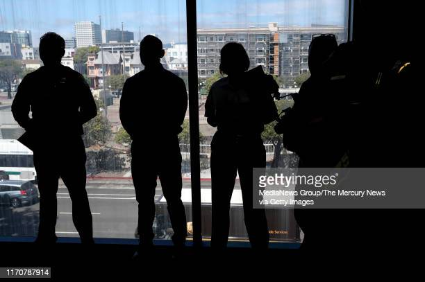 Other officers watch as new BART police officers Joseph Alvarez Steven Saechao and Miguel Llamas are sworn in by interim police Chief Ed Alvarez...