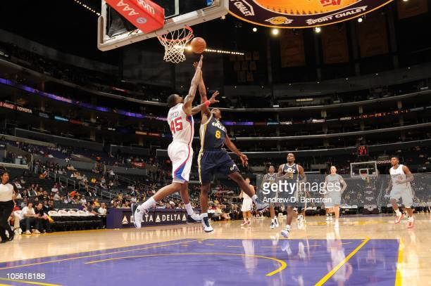 Othyus Jeffers of the Utah Jazz goes up for a shot against Rasual Butler of the Los Angeles Clippers at Staples Center on October 16 2010 in Los...