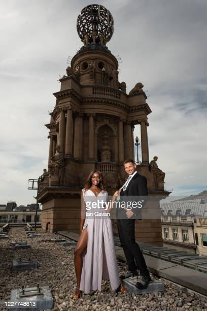 Oti Mabuse and husband Marius Lepure pose on the roof of the London Coliseum on July 23, 2020 in London, England. Oti Mabuse and husband Marius...