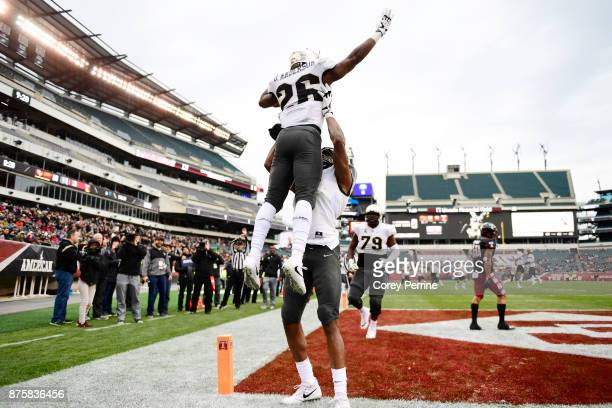 Otis Anderson of the UCF Knights is hoisted by teammate Tre'Quan Smith after scoring a touchdown against the Temple Owls during the second quarter at...