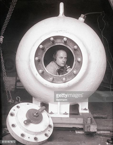 Otis Barton inventor of the Barton tank is shown here in the tank The tank is to be used by William Beebe in his deep sea exploration expedition near...