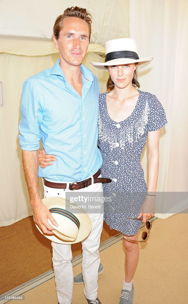 Otis Ferry (L) and Edie Campbell attend the Veuve Clicquot Gold Cup Final at Cowdray Park Polo Club on July 21, 2013 in Midhurst, England.