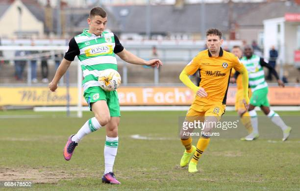 Otis Khan of Yeovil Town is closely marked by Mark Randall of Newport County during the Sky Bet League Two match between Newport County and Yeovil...