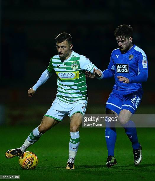 Otis Khan of Yeovil Town is tackled by Matt Tootle of Notts County during the Sky Bet League Two match between Yeovil Town and Notts County at Huish...