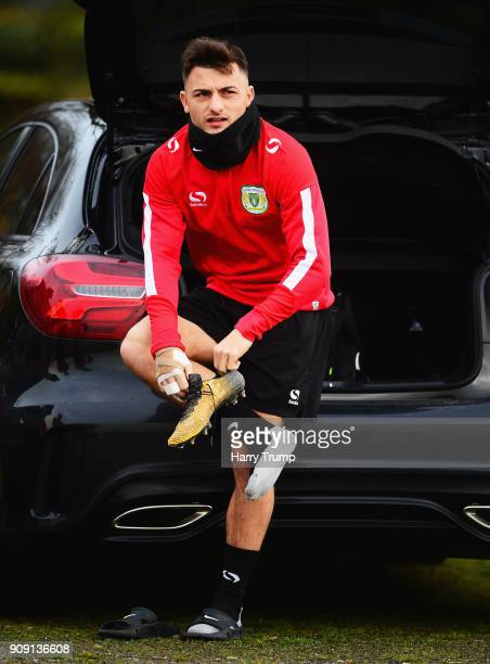 Otis Khan of Yeovil Town puts on his boots in the back of his car prior to a training session during the Yeovil Town media access day at Huish Park...