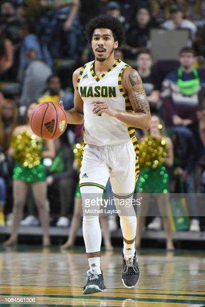 Otis Livingston II of the George Mason Patriots dribble sup court during a college basketball game against the Southern University Jaguars at the...