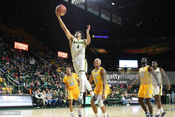 Otis Livingston II of the George Mason Patriots drives to the basket during a college basketball game against the Southern University Jaguars at the...