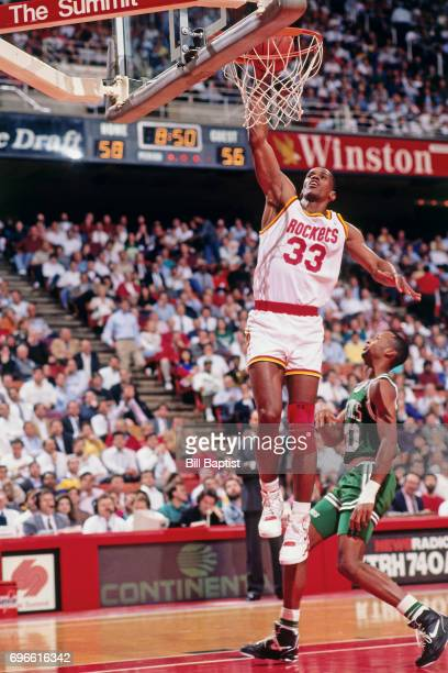 Otis Thorpe of the Houston Rockets goes to the basket against the Boston Celtics during a game played circa 1988 at the Summit in Houston Texas NOTE...