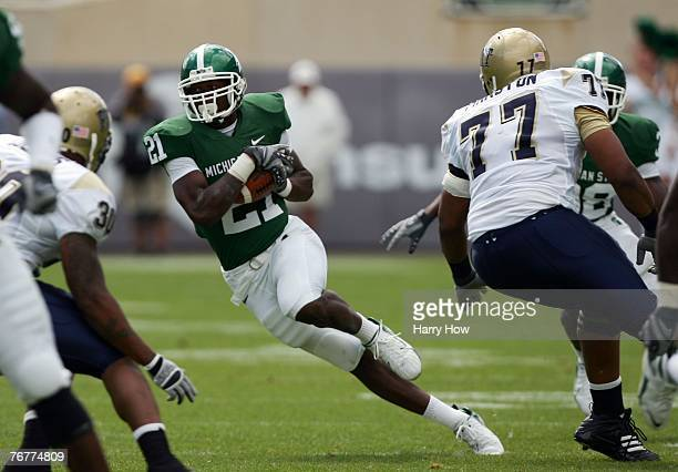 Otis Wiley of the Michigan State Spartans runs back his interception past Jason Pinkston of the Pittsburgh Panthers during the first quarter at...