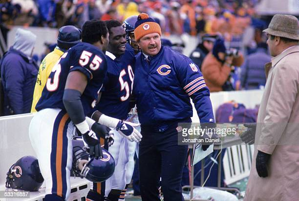 Otis Wilson Wilber Marshall and head coach Mike Ditka of the Chicago Bears stand on the sideline during a game in the 1985 season at Soldier Field in...