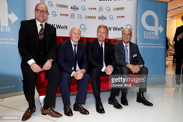 Otmar Ehrl Dirk Rossmann Christian Wulff and Juergen Heraeus attend the Querdenker Award 2014 at BMW World on November 25 2014 in Munich Germany