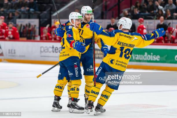 Otso Rantakari of HC Davos celebrates his goal with teammates during the Swiss National League game between Lausanne HC and HC Davos at Vaudoise...