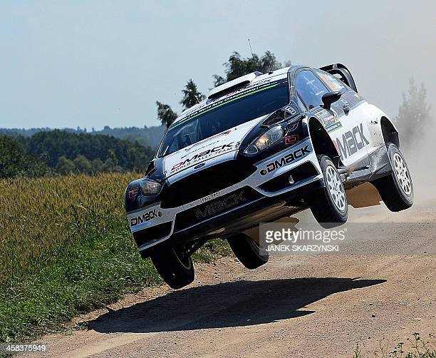 Ott Tanak and codriver Raigo Molder of Estonia drive their Ford Fiesta RS WRC during the special stage at the Rally Poland in Stanczyki northern...