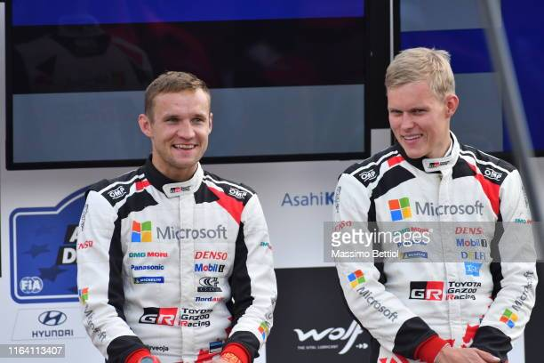 Ott Tanak and Martin Jarveoja of Estonia celebrate their victory on the final podium of Bostalsee during Day Three of the FIA World Rally...