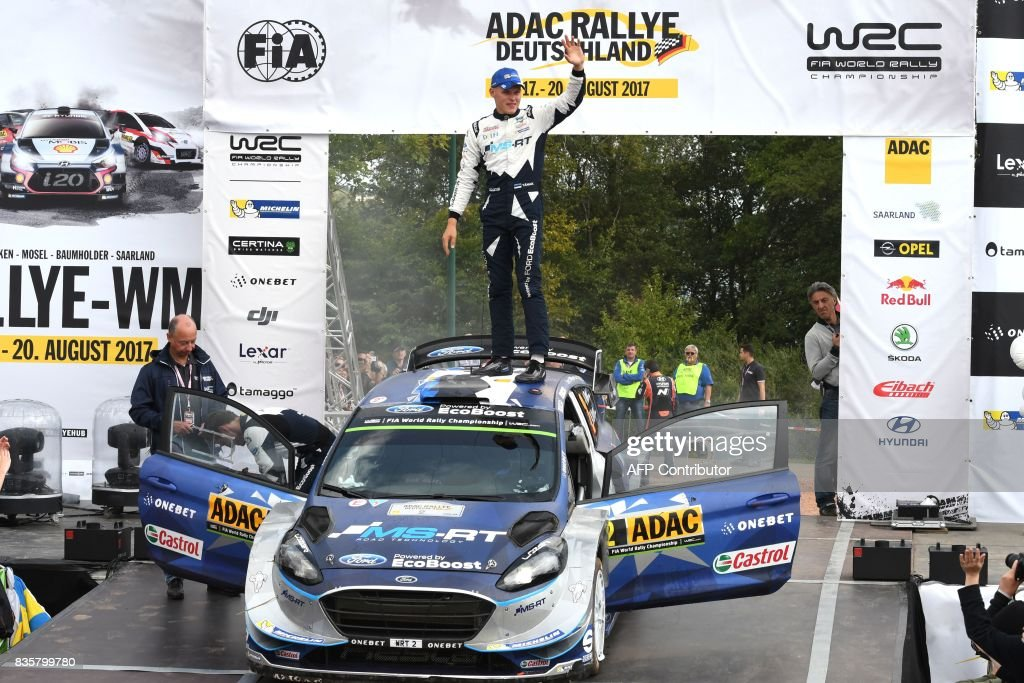 Ott Tanak of Estonia and his co- driver Martin Jarveoja of Estonia celebrate after they finish at the first place in front of Andreas Mikkelsen and Anders Jaeger of Norway and 3rd place Sebastien Ogier and Julien Ingrassia of France during the WRC Germany on August 20, 2017 in Neunkirchen, western Germany, near Saarbruecken. /