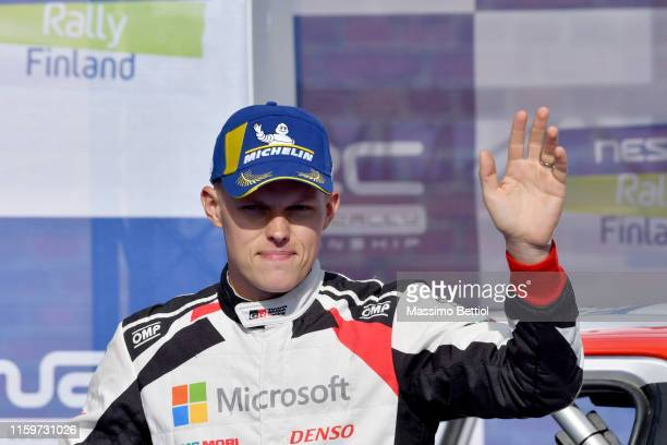 Ott Tanak of Estonia and Martin Jarveoja of Estonia are celebrating their victory in the final podium during Day Three of the FIA WRC Neste Finland...