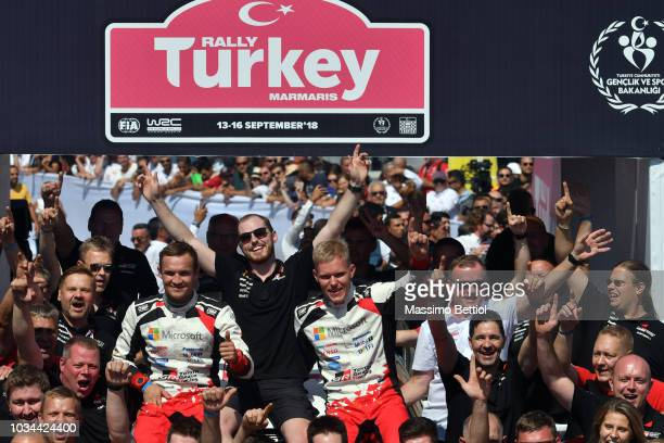 Ott Tanak of Estonia and Martin Jarveoja of Estonia celebrate their victory in the final podium during Day Three of the WRC Turkey on September 16...