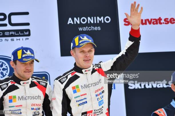 Ott Tanak of Estonia and Martin Jarveoja of Estonia celebrate their victory in the final podium during Day Three of the WRC Sweden on February 17...