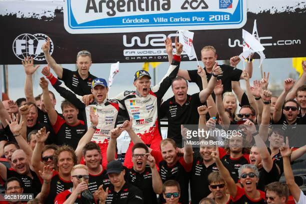 Ott Tanak of Estonia and Martin Jarveoja of Estonia celebrate their victory in the final podium in Villa Carlos Paz during Day Four of the WRC...