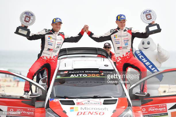 Ott Tanak of Estonia and Martin Jarveoja of Estonia celebrates the victory of the rally at the award ceremony awards for the WRC Portugal on June 02...