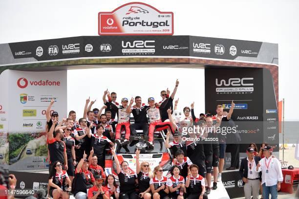 Ott Tanak of Estonia and Martin Jarveoja of Estonia celebrates with their Toyota Gazoo Racing WRT team members the victory of the rally at the award...