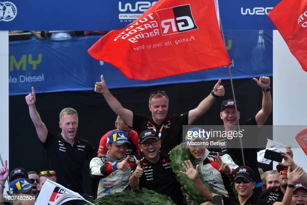 Ott Tanak of Estonia and Martin Jarveoja of Estonia together President Toyota Mr Akio Toyoda are celebrating their victory during Day Four of the WRC...