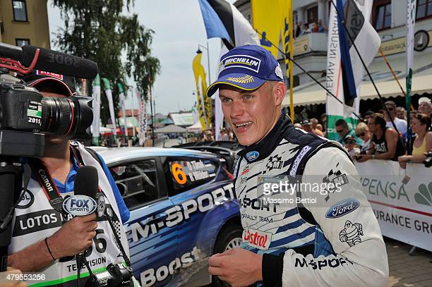 Ott Tanak of Estonia and Raigo Molder of Estonia celebrate their third position in the final overall during Day Three of the WRC Poland on July 5...
