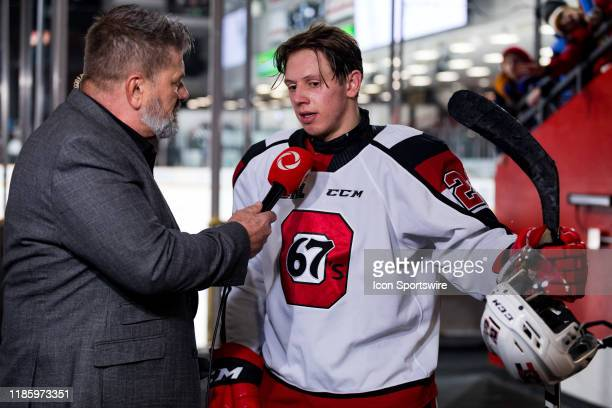 Ottawa 67's Center Marco Rossi is interviewed by Rogers TV Kurt Stoodley after Ontario Hockey League action between the North Bay Battalion and...