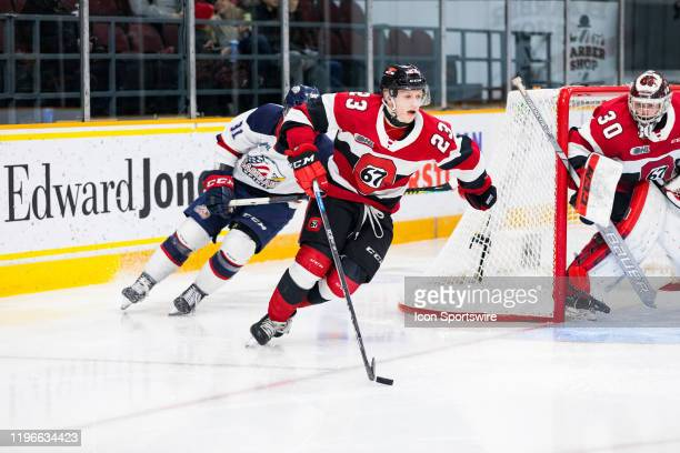 Ottawa 67's Center Marco Rossi skates the puck out from behind the net during Ontario Hockey League action between the Saginaw Spirit and Ottawa 67's...