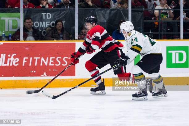 Ottawa 67's Forward Oliver True tries to get around London Knights Defenceman Andrew Perrott during Ontario Hockey League action between the London...