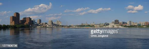ottawa and gatineau city skyline over river - ガティノー ストックフォトと画像