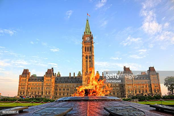 ottawa parliament hill with centennial flame - canadian culture stock pictures, royalty-free photos & images