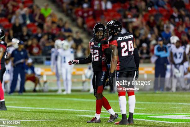 Ottawa RedBlacks defensive back Nicholas Taylor talks to talks to defensive back AJ Jefferson during Canadian Football League action between the...