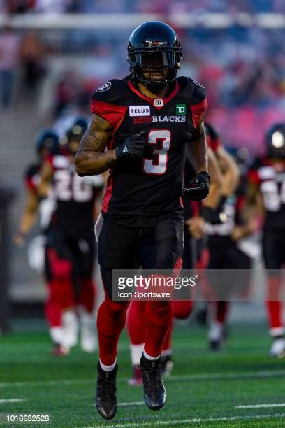 Ottawa Redblacks defensive back Rico Murray runs onto the field for player entrance during Canadian Football League action between the Montreal...