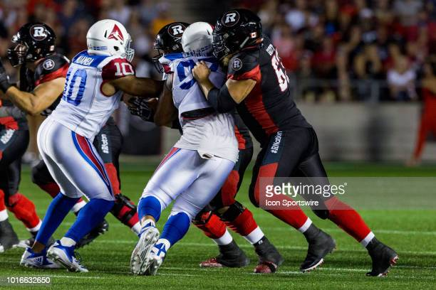 Ottawa Redblacks offensive lineman Jon Gott battles Montreal Alouettes defensive tackle Woody Baron during Canadian Football League action between...