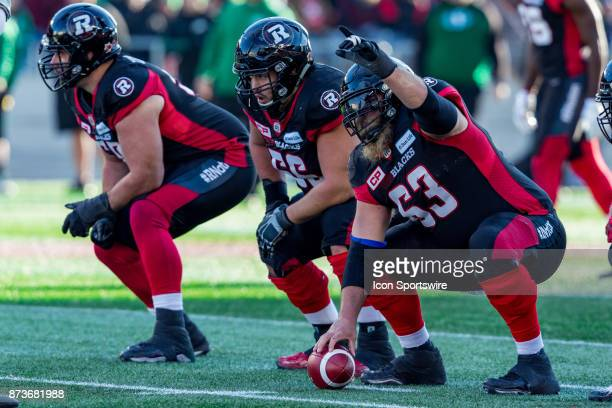 Ottawa RedBlacks offensive lineman Jon Gott makes a gesture prior to the snap during Canadian Football League Eastern SemiFinal playoff action...