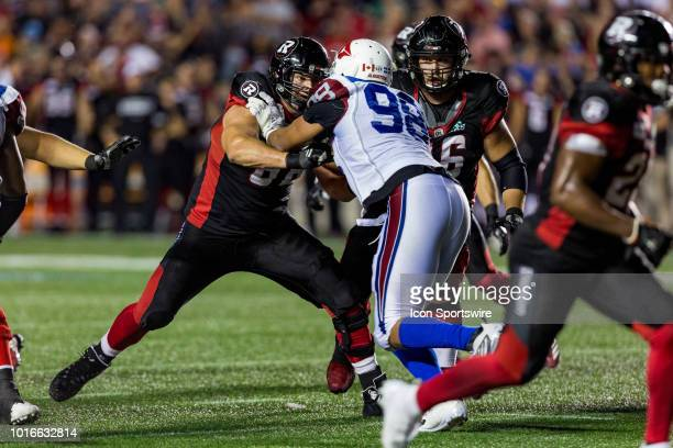 Ottawa Redblacks offensive lineman Nolan MacMillan and Ottawa Redblacks offensive lineman Alex Mateas work to block Montreal Alouettes defensive...