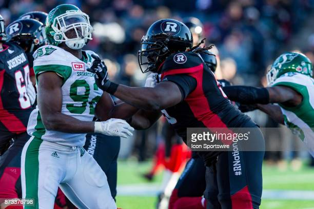 Ottawa RedBlacks offensive lineman SirVincent Rogers battles Saskatchewan Roughriders defensive lineman Tobi Antigha during Canadian Football League...