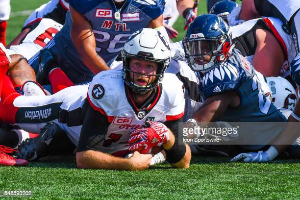 Ottawa Redblacks quarterback Ryan Lindley looking up after a successful quarterback sneak during the Ottawa RedBlacks versus the Montreal Alouettes...