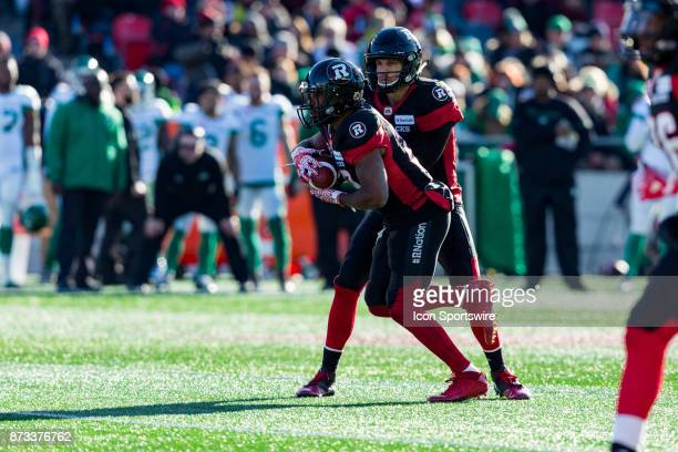 Ottawa RedBlacks quarterback Trevor Harris hands off to running back William Powell during Canadian Football League Eastern SemiFinal playoff action...